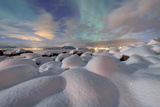 The Aurora Borealis (Northern Lights) Illuminate Snowy Landscape on a Starry Night Stronstad