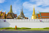 A Monk Passes in Front of Wat Phra Kaew and the Grand Palace  Bangkok  Thailand