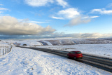 Motorists Negotiate the B4520 Road Between Brecon and Builth Wells on the Mynydd Epynt Moorland