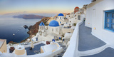 White Houses and Blue Domes of the Churches Dominate the Aegean Sea  Oia  Santorini