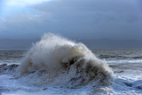 Huge Waves Crash Against a Stone Jetty at Criccieth  Gwynedd  Wales  United Kingdom  Europe