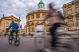 Cyclists Passing the Sheldonian Theatre  Oxford  Oxfordshire  England  United Kingdom  Europe