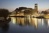 Royal Shakespeare Theatre Lit Up at Dusk Beside River Avon  Stratford-Upon-Avon  Warwickshire