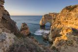 Sunrise on the Cliffs and Turquoise Water of the Ocean  Praia Da Marinha  Caramujeira