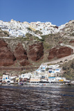 Typical Greek Village Perched on Volcanic Rock with White and Blue Houses and Windmills  Santorini