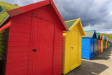 Row of Colourful Beach Huts and their Shadows  with Grassy Cliffs  West Cliff Beach