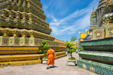 A Monk Walks Past Stupas at Wat Pho (Temple of the Reclining Buddha)  Bangkok  Thailand
