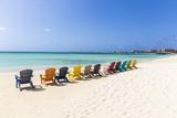 A Row of Colourful Wooden Deckchairs on Palm Beach  Aruba  Netherlands Antilles