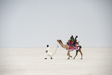 Indian Family Enjoying a Camel Ride in the White Desert