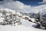 The Winter Sun Shines on the Snowy Mountain Huts and Woods  Bettmeralp  District of Raron
