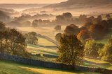 The Littondale Valley Lit by Early Morning Light on a Misty Autumn Morning in Yorkshire Dales