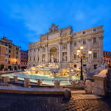 Panorama of Trevi Fountain Illuminated by Street Lamps and the Lights at Dusk  Rome  Lazio