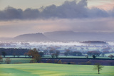 Low Winter Light Rakes across Cheshire Plain with Beeston Castle and Peckforton Sandstone Ridge