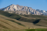 A Distant House in the Grasslands with Views of Mountains in the Distance  Bamiyan Province