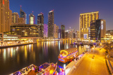 Dubai Marina Skyline and Tourist Boats at Night  Dubai City  United Arab Emirates  Middle East