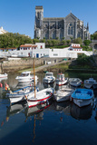 Small Port with Traditional Fishing Boats and Eglise Sainte Eugenie in Biarritz