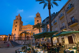 People Dining in Piazza Duomo in Front of the Norman Cathedral of Cefalu Illuminated at Night