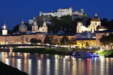 City at Night of Salzach River with Churches of Salzburg and Hohensalzburg Fortress  Austria