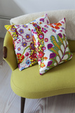 Floral Cushions on Retro Sofa in Living Room of London Family Home  UK