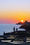Mediterranean Europe  Malta  Gozo Island  Xwejni Bay  Fisherman at the Salt Pans at Sunrise