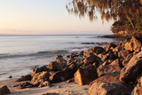 Warm Glow of Sunset on a Boulder-Strewn Beach on Noosa Heads  the Sunshine Coast  Queensland