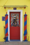 Colourful  Ornate Traditional Doorway and Striped Mooring Posts in the Town of Burano  Venice