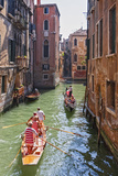 Local Gondaliers Row their Traditional Boat in One of Cannaregios Canals  Cannaregio  Venice