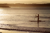 A Woman on a Stand-Up Paddleboard Heads Towards Main Beach  Noosa  at Sunset