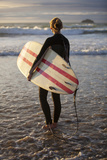 Uk  Cornwall  Polzeath a Woman Looks Out to See  Preparing for an Evening Surf Mr