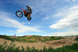 A Rider Sails Through the Air at a Motocross Event