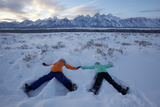 Boy and Girl Making Snow Angels Below the Tetons  Grand Teton National Park  Wyoming