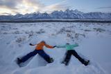 Boy and Girl Making Snow Angels Below the Tetons  Grand Teton National Park  Wyoming