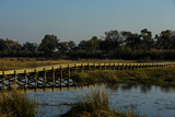 A Long Wooden Bridge over a Spillway