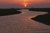 Dwelling Mounds in the Wadden Sea at Sunset
