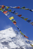 Prayer Flags in Front of Himalayan Mountain Range in Nepal