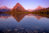 The Sunrise on Mount Grinnell as Seen from Swiftcurrent Lake