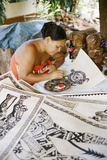 An Artist Works on Traditional Tapa Drawings