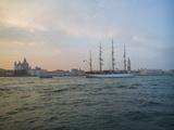 A Sailing Ship Makes its Way Along the Venice Waterfront