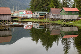 Houses of an Alaskan Fishing Village Reflect in Water