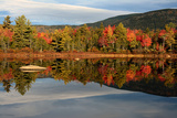 Scenic View of Trees and Hills Reflected in the Still Water of a Pond in Autumn