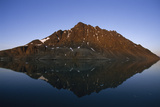 Rock Mountain in a Fjord Reflected in the Calm Sea