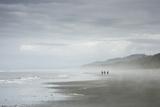 Hikers on the Coast Sand Beach in Olympic National Park  Washington