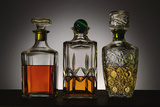 Glass and Crystal Decanters Containing Brandy and Whiskey