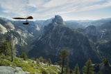 Hang Glider Flying over the Half Dome Mountain and Yosemite Valley