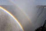 Rainbows Form in the Spray over Victoria Falls  Zambia