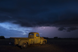 A 1951 International Harvester Pickup Truck at a Farm During a Thunderstorm