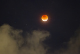 A Break in the Clouds Reveals a Rare Lunar Eclipse  also known as the Super Moon