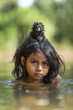 A Pet Saddleback Tamarin Hangs on Tight to a Matsigenka Girl as She Swims in the Yomibato River