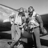 Tuskegee Airmen Posing with a P-51D Aircraft