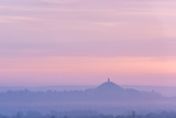 Glastonbury Tor Rising Surrounded by Mist at Dawn  Somerset  England Summer 2013